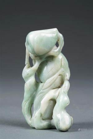 POIDS A ROULEAUX EN JADE JADEITE Chine, Epoque XXe siècle Sculpté dans une pierre d'un blanc la
