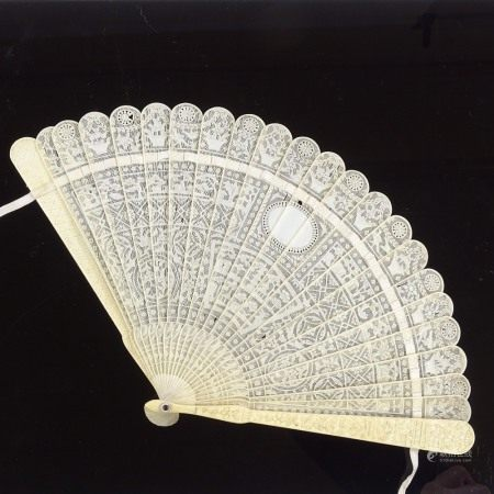 A Chinese relief carved ivory Brise fan, late 18th/early 19th century, with details floral