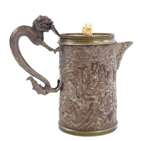 A Chinese mixed metal lidded jug with dragon handle and relief decorated sides, height to rim 11cm