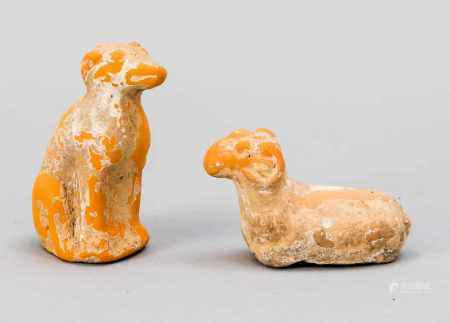 Sitting dog and ram, China, Tang Dynasty. Orange-brown ceramic with remains of earth, h.