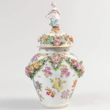 Continental Porcelain Vase and Cover with Figural Finial
