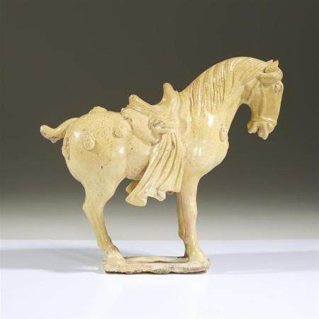 A Chinese straw-glazed pottery horse, in Tang dynasty style,