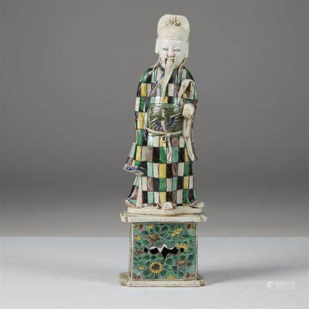 A Chinese famille verte porcelain figure of a deity, Kangxi