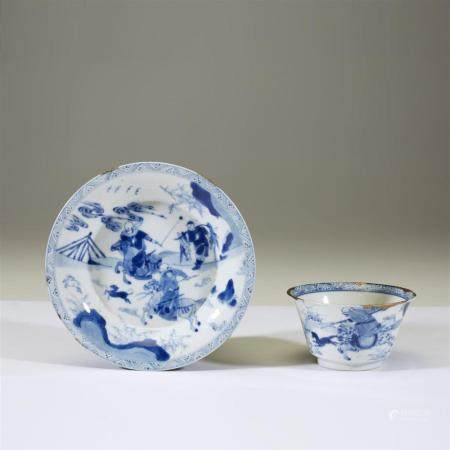 "A Chinese blue and white porcelain ""Hunters"" tea bowl and sa"