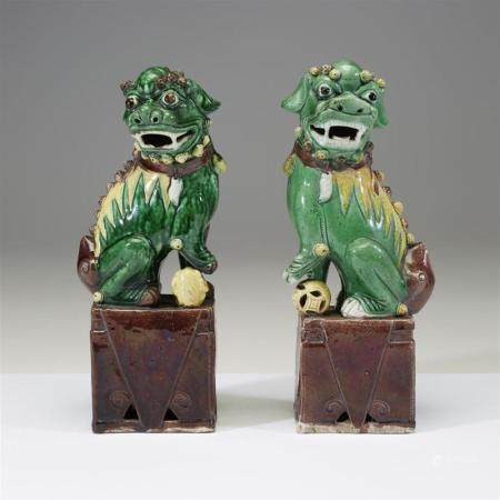 An associated pair of Chinese sancai-glazed porcelain Buddhi
