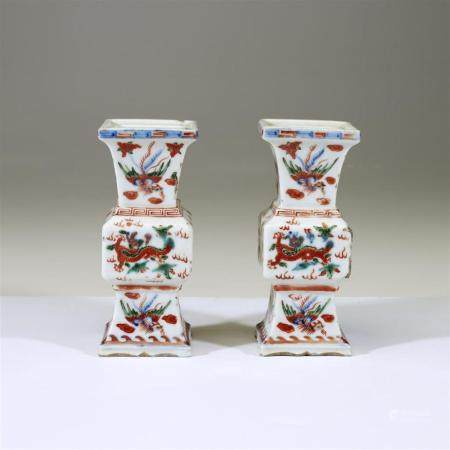 A pair of small Chinese wucai-decorated porcelain vases, apo