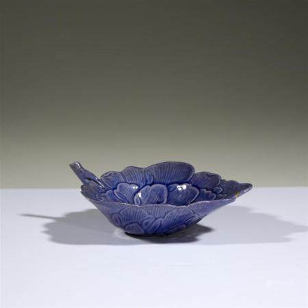"A Chinese violet blue-glazed ""Peony"" cup, Guangxu period or"