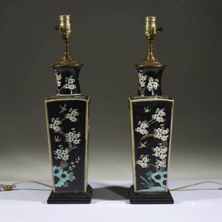 A pair of famille noir-decorated porcelain vases mounted as