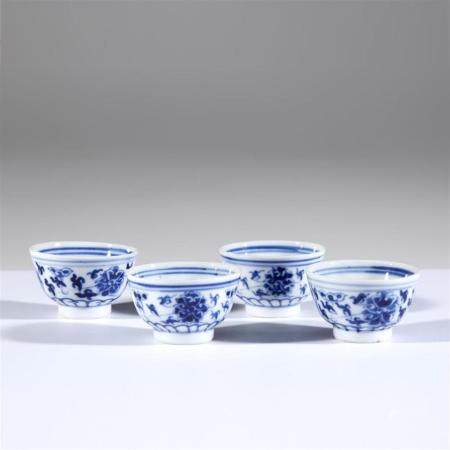Four Chinese blue and white porcelain lotus-scroll decorated