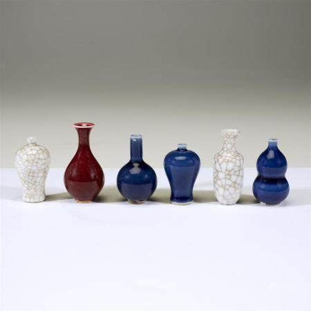 A group of six Chinese miniature porcelain vases,
