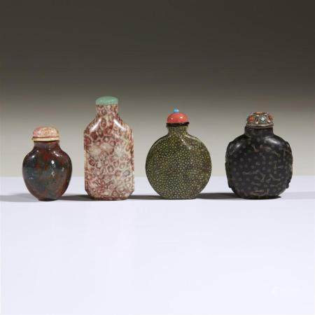 Three Chinese carved hardstone snuff bottles and a faux shag
