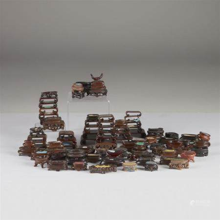 A large collection of assorted Chinese snuff bottle stands a