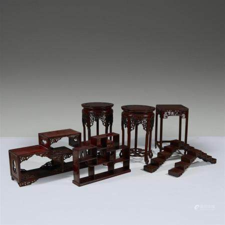 A group of seven assorted Chinese hardwood stands,