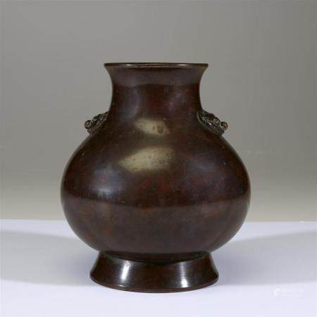 A Chinese archaistic patinated bronze vase, 18th/19th centur