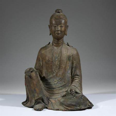 A Chinese bronze figure of a seated deity,