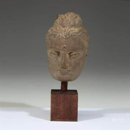 A Gandharan carved stone face of a Buddha,