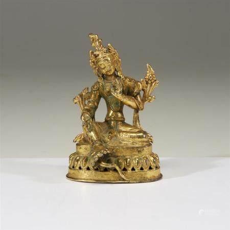 A small gilt metal figure of Tara,