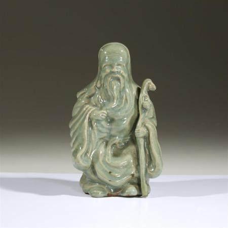 A Japanese celadon-glazed figure of Jurojin, probably Edo pe