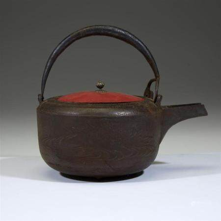 A Japanese cast iron kettle and a cast iron hibachi,