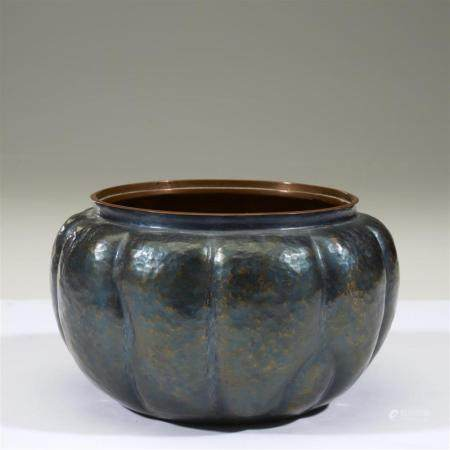 A Japanese hammered and patinated metal bowl, signed Minagaw