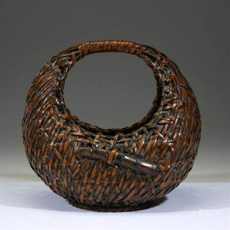 "A Japanese woven bamboo ""Moon"" basket, signed Kogetsu, 20th"