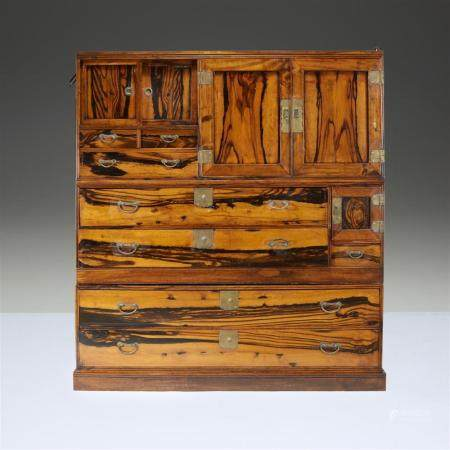 A Japanese three-part persimmon wood tansu,