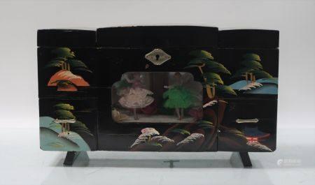 Poudreuse musical. Indochine, XXème siècle. 20x33x14cm