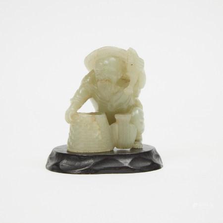 "A Celadon Jade Figure of a Fisherman 青玉雕 ""漁翁得利""擺件"