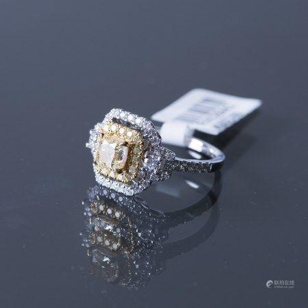 A FANCY YELLOW DIAMOND RING, AIG CERTIFIED