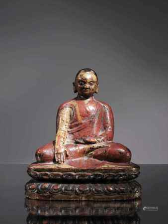 LAMAWood paintedTibet , 16th centuryDimensions: Height 15 cm Weight: 318 gramsLama seated on