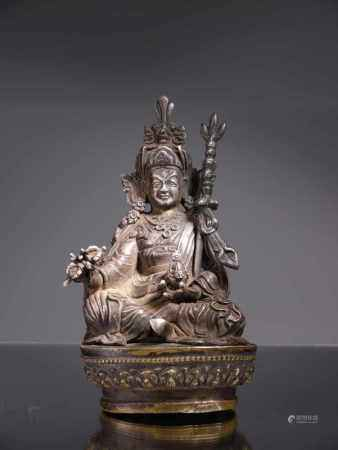 PADMASAMBHAVASilver sculpture on bronze base,Tibet or Bhutan , 18th centuryDimensions: Height 14