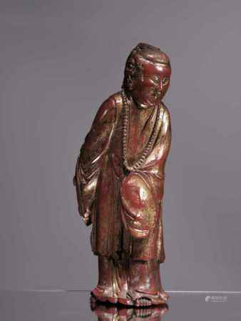 VIETNAMESE SCHOLARWood red and gold lacquered Vietnam , 18th century Dimensions: Height 32 cmWeight: