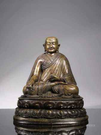 LARGE BRONZE LAMA WITH VAJRA AND GHANTABronze,Tibet , 16th centuryDimensions: Height 36 cmWeight: