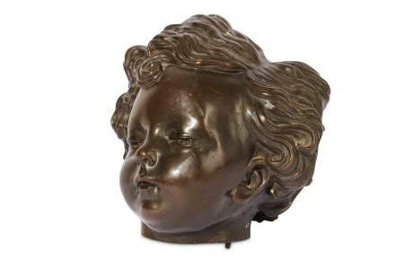 A LATE 18TH CENTURY BRONZE MODEL OF A CHILD'S HEAD IN THE MANNER OF JEAN-BAPTISTE PIGALLE