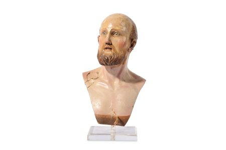 AN 18TH CENTURY NEAPOLITAN CARVED WOOD AND POLYCHROME DECORATED BUST OF A MAN