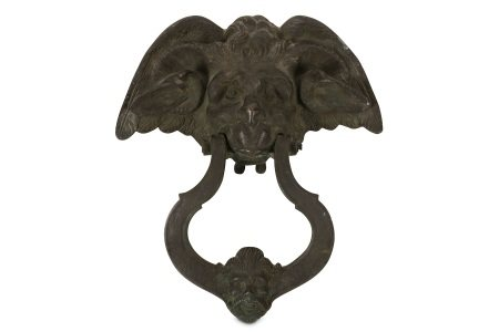 A 19TH CENTURY CAST IRON DOOR KNOCKER MODELLED WITH A DEVIL