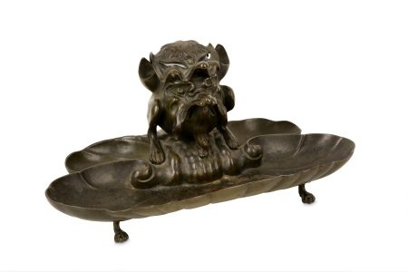 A 19TH CENTURY BRONZE INKWELL FORMED AS A GROTESQUE BEAST
