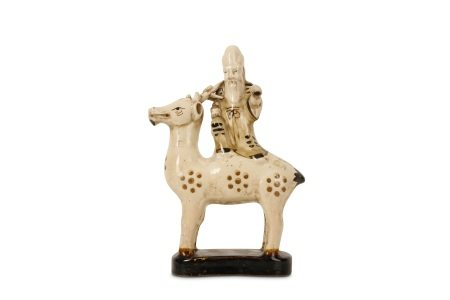A CHINESE POTTERY FIGURE OF SHOULAO ON A DEER.