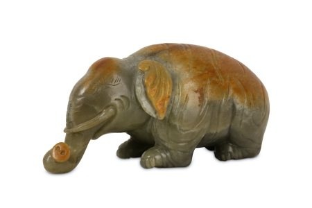 A CHINESE PALE CELADON JADE ELEPHANT.