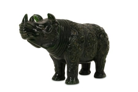 A CHINESE SPINACH GREEN JADE 'RHINOCEROS' CARVING.