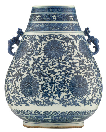 A Chinese blue and white archaistic hu-vase, the pear-shaped body densely decorated with lotus scrolls, late Qing Dynasty, H 48 cm