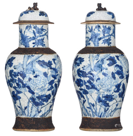 A pair of Chinese blue and white stoneware vases and covers, decorated with flowers and birds, marked, 19thC, H 46,5 cm