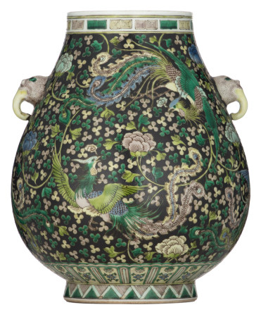 A Chinese black ground famille verte hu-vase, decorated with phoenix, H 30 cm