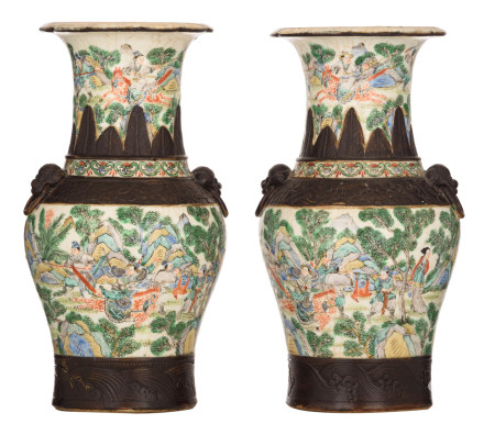 Two Chinese crackleware ground famille verte Nanking vases, all-over decorated with animated scenes with figures in a mountainous landscape, 19thC, marked, H 35,5 - 36,5 cm