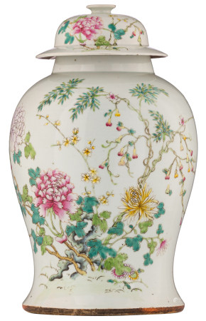 A Chinese famille rose vase and cover, decorated with flowers, flower branches and bats, with a four-charactermark, 19thC, H 41 cm