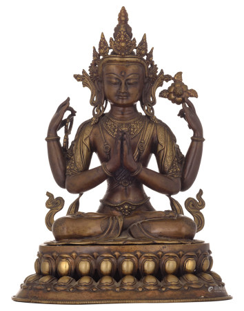 A Tibetan bronze statue of a seated four-armed Buddhist figure, on a double lotus flower base, 18th/19thC, H 44 - W 33 - D 26 cm