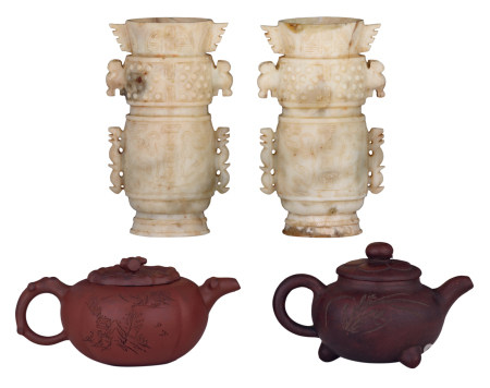 Two Chinese Yixing teapots and covers with calligraphic texts, marked; added two Chinese carved stone archaic vases, H 10 - 19 cm