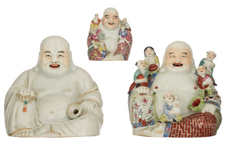 Three Chinese polychrome decorated Budai, two figures holding a chain of praying beads, two figures surrounded by children, with an impressed mark, H 15 - 27 - W 13 - 27,5 - D 8 - 24,5 cm