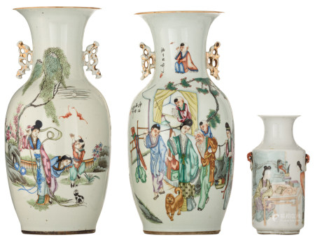 Two Chinese famille rose vases, decorated with figures, flowers and playing children, one vase double decorated, the back with calligraphic texts; added a smaller ditto polychrome cylindrical vase, marked, H 23 - 43,5 cm