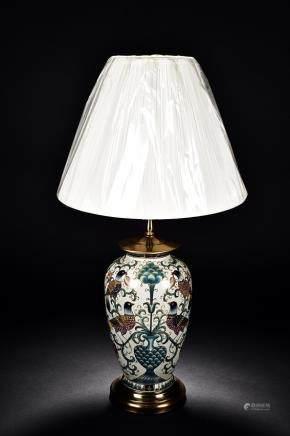 A PORCELAIN LAMP VASE